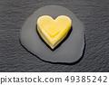 Melting butter heart 49385242