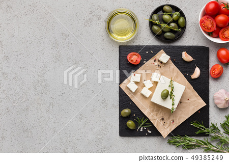 Block of butter and spices on concrete background 49385249