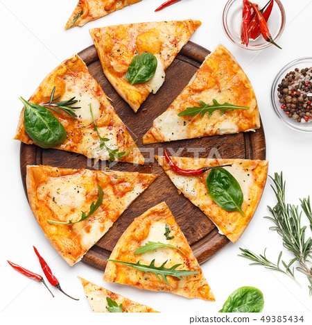Slices of cheese pizza served on wooden board 49385434