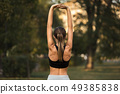Sporty young woman runner warming up outdoor 49385838