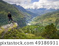 Man standing on hill top in Himalayas 49386931