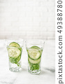 Detox infused water with cucumber and basil 49388780