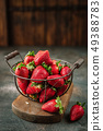 Fresh juicy strawberries in basket with leaves on 49388783