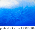 Blue acrylic ink dissolving into water, close up 49393606