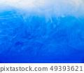 Drop of acrylic ink dissolved into water, close up 49393621