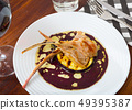 Baked ribs of lamb with eggplant in wine sauce 49395387