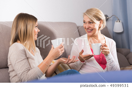Mom and adult daughter talking 49399531