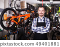 Mechanic in bicycles store workshop 49401881