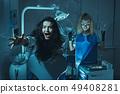 Horror scene in dentist office 49408281