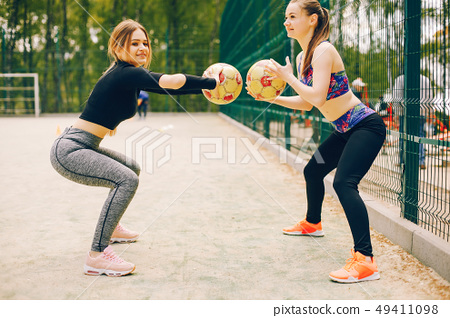 Sports girls in a park  49411098