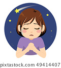 Little sad crying girl praying for wish at night 49414407