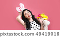 Young woman with Easter basket 49419018