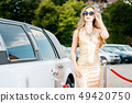 Woman getting out of limousine car 49420750