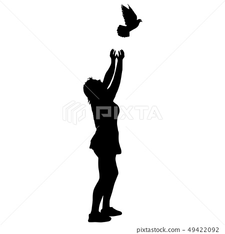 Silhouette girl releases doves into the sky 49422092