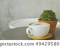 Coffee on the desk, copy space background 49429580