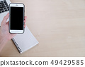 Top view of woman hand use cell phone on the table 49429585