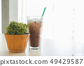 Iced chocolate and small tree on the desk 49429587