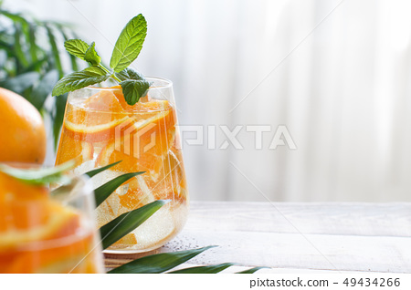 Homemade refreshing drink with soda and orange 49434266