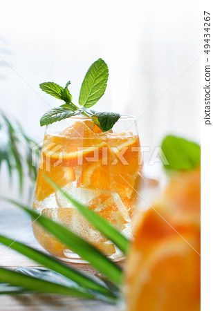 Homemade refreshing drink with soda and orange 49434267