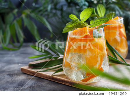 Homemade refreshing drink with soda and orange 49434269