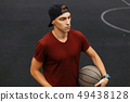 Man with ball 49438128