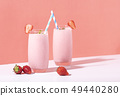 Strawberry smoothie in glass with straw  49440280