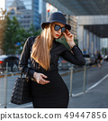 Successful stylish young girl 49447856