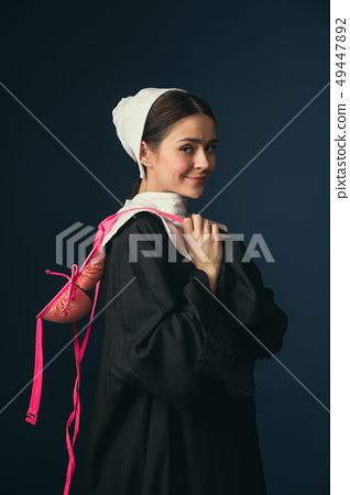 Medieval young woman as a nun with bra 49447892