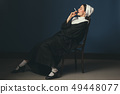 Medieval young woman as a nun 49448077