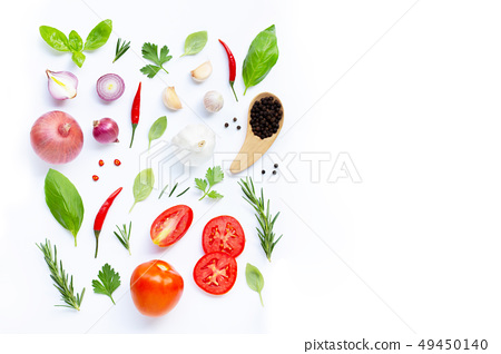 Various fresh vegetables and herbs on white 49450140