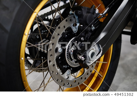 Disc brake with wheel hub on a motorcycle. Close 49451302