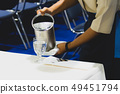 Waiter pouring water into glasses , Restaurants 49451794