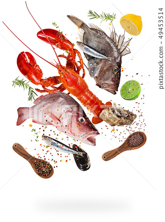 Flying raw sea fish with ingredients for cooking. Food preparation concept 49453514