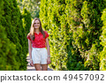 Beautiful smiling woman walking on the road 49457092