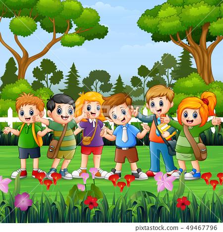 Happy school children standing in the park 49467796