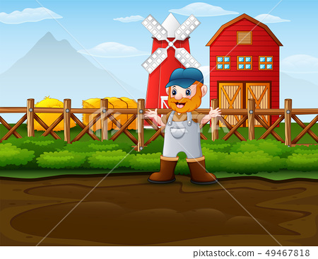 Happy farmer man standing in front of his barn 49467818