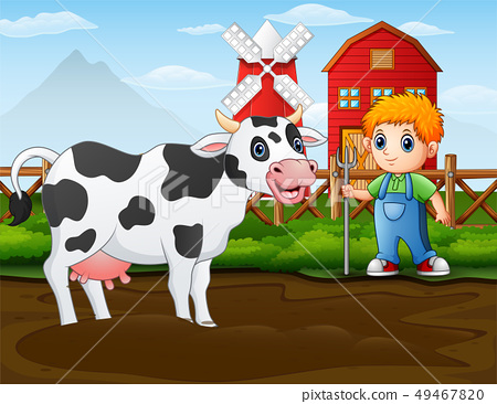 Farmer with a cow in front of his barn 49467820