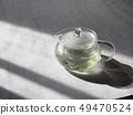 กาน้ำชาแก้วและชาเขียว 49470524