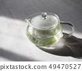 กาน้ำชาแก้วและชาเขียว 49470527