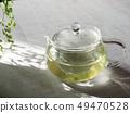 กาน้ำชาแก้วและชาเขียว 49470528