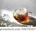 กาน้ำชาแก้วและชา 49470567