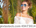 Summer woman on a background of palm trees 49473614