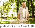 Gloomy Man Walks in Park. Outdoor Rehabilitation. 49474804