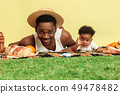 Happy family having picnic at studio 49478482