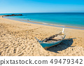 Tropical landscape with boat at sand beach 49479342