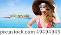 Happy young woman at beach in summer vacation. 49494943