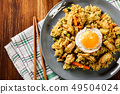 Fried rice nasi goreng with chicken egg and 49504024