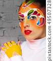 Beautiful young model with bright creative make up 49507328