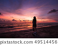 Silhouette of Asian girl on the beach on sunset 49514456
