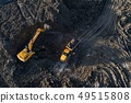 Aerial drone view of excavator loading the tipper 49515808